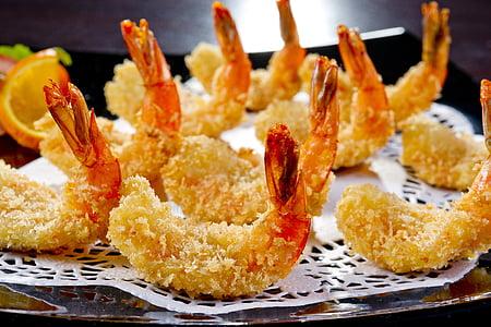 fried shrimps on white surface