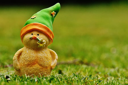 brown ceramic gnome on grass