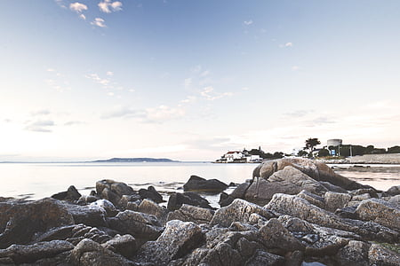 landscape photography of rocks and sea
