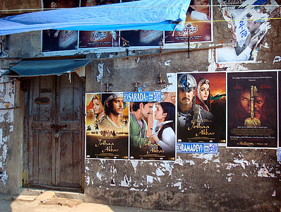 assorted movie poster on wall