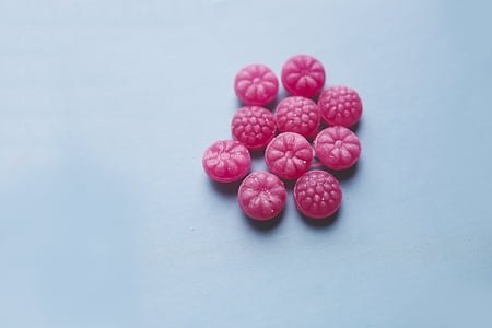 round pink candies on blue panel