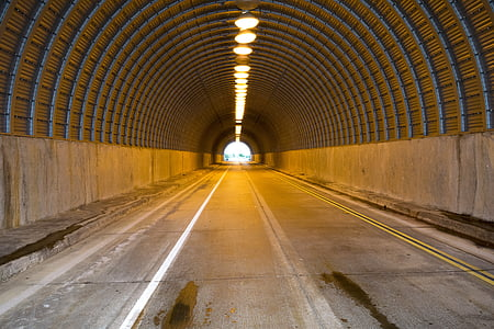 gray concrete tunnel road