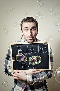 man showing Bubbles for free signboard