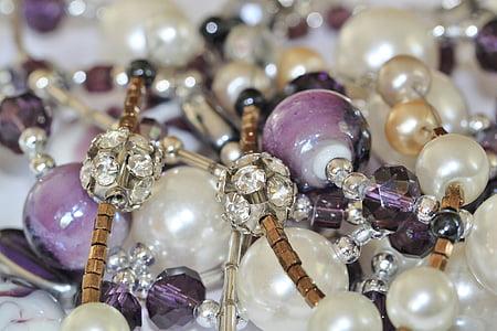 beaded purple and white bands closeup photo