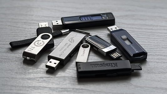 gray flash drives on gray table