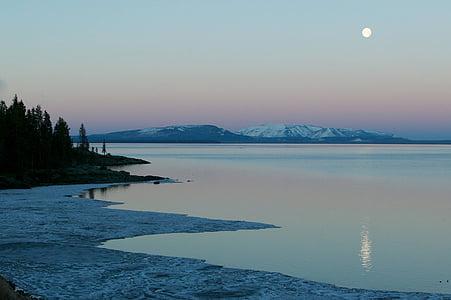 white mountain beside body of water
