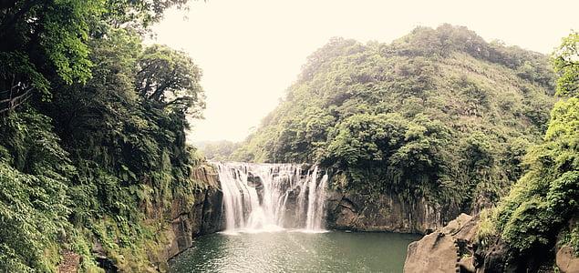 close-up photo of waterfalls near trees