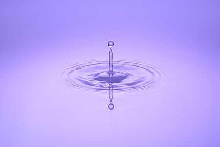 water drop with purple background