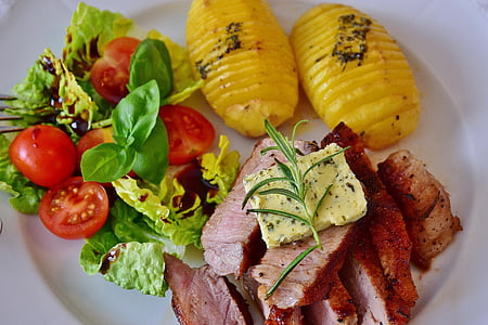 grilled meat ; yellow sliced cheese . two yellow slice pineapples on round white ceramic plate