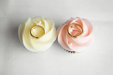 two gold-colored rings on flower decors