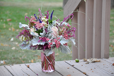 assorted-color artificial flowers table decor