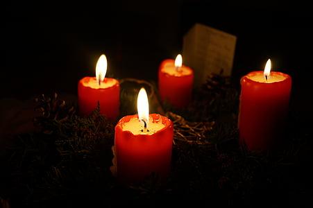 four red pillar candles