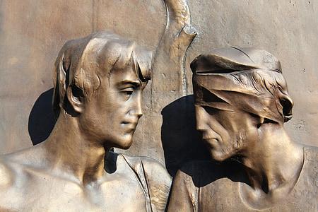 two men brass figures