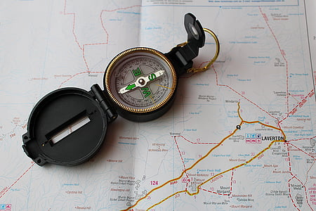 black compass on map