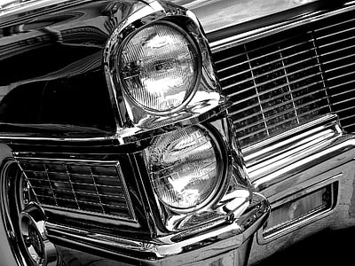 grayscale photo of classic vehicle