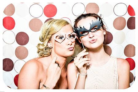 two women holding eye masks