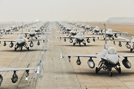gray fighter jets on runway during daytime
