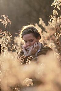 girl wearing brown coat at daytime