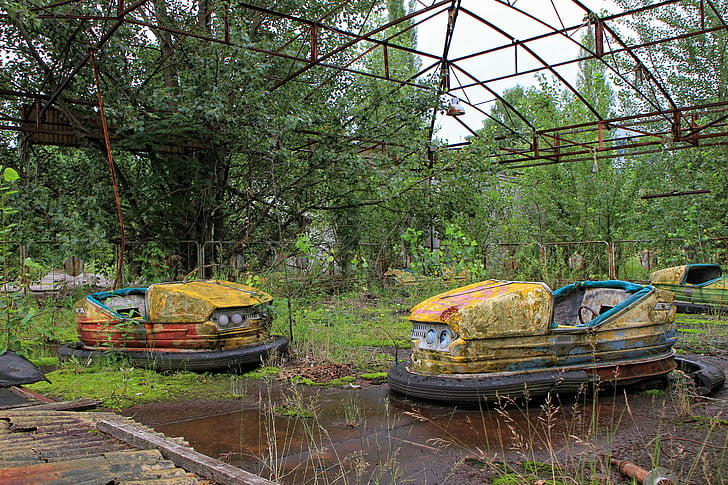two yellow abandoned bumper cars at daytime
