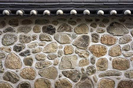 closeup photo of white and brown bricks