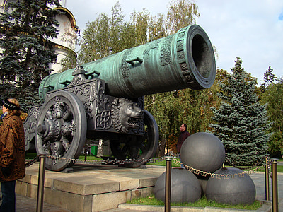 teal and gray metal cannon monument during daytime