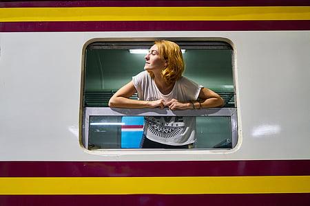 woman leaning on train window