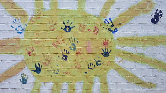 assorted-color of hand prints printed on wall