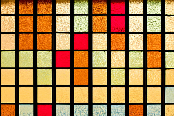 yellow, red, brown, and blue checkered surface
