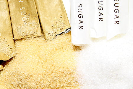 white and brown sugars with packs
