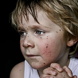 praying boy with dust on face