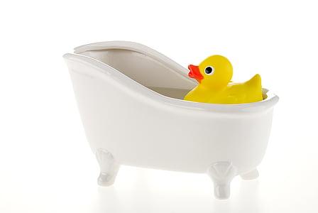 rubber ducky white bathtub on bathtub