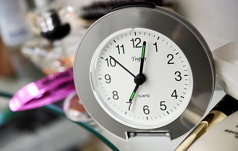 round silver analog clock reading at 7:03