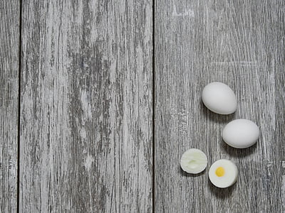 hard-boiled egg on gray wooden surface