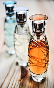 three glass bottles on table