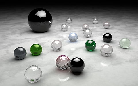 black, green, and grey balls