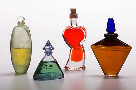 four assorted glass fragrance bottles