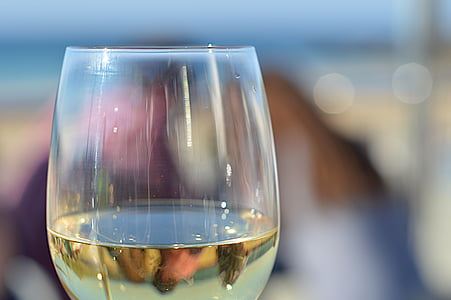close up photography of clear wine glass