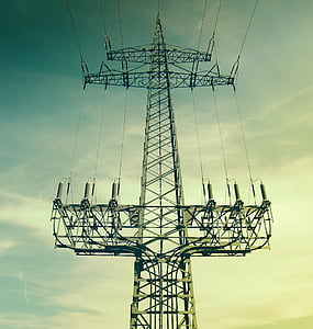 low-angle photography of transmission tower under white and blue sky at daytime
