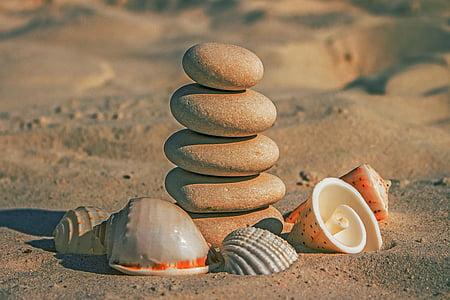shallow focus photography of rock balancing during daytime