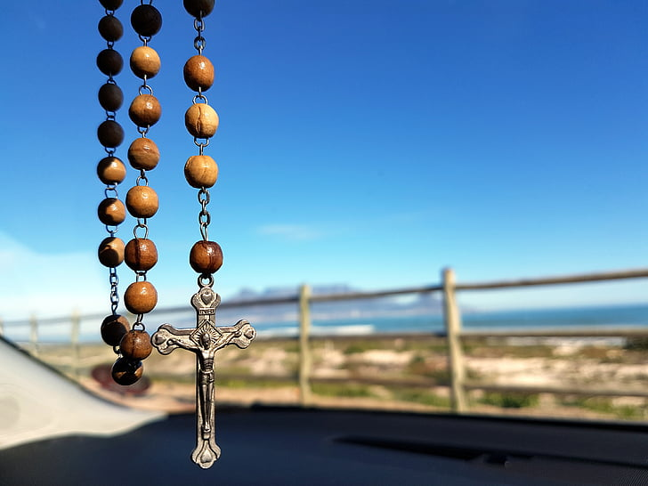 brown rosary selective focus photography