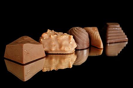 photo of five brown chocolates