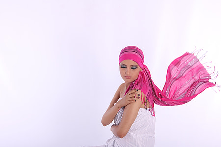 woman in white strapless top and pink headdress