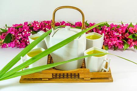 white ceramic 5-piece tea set placed on beige wooden tray