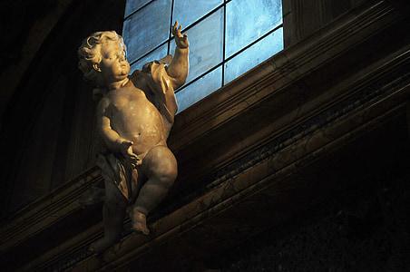 cherub angel near window