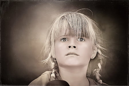 grayscale photo of girl with braided hair