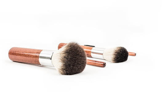 two brown-and-white makeup brush