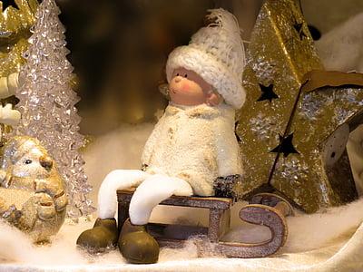 dwarf figurine on brown sled
