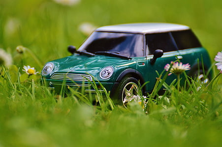 closeup photo of green Mini Cooper scale model on green grass