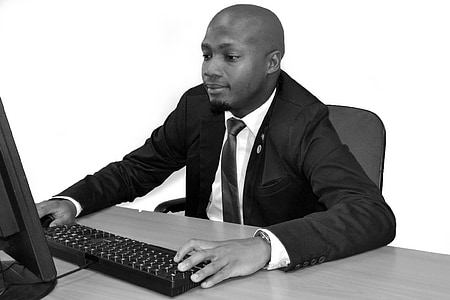 man holding computer keyboard