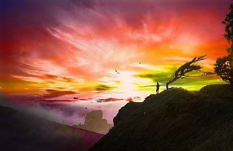 silhouette of person near mountain